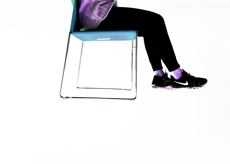 Floating Image of person sitting on chair